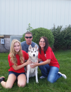 The Bakalar Family with their foster dog - Kandy.