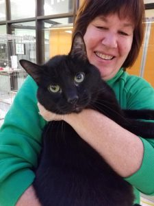 Tracy Isenberg holds one of our cats on her way to take a picture for our 12 Cats of Christmas!